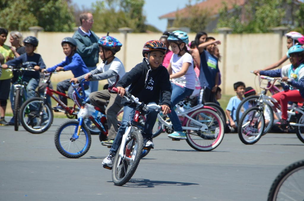 Elementary school child riding his bike through the bike rodeo course.